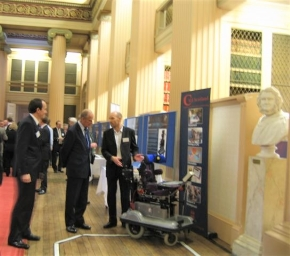 The Duke of Edinburgh discussing the smart wheelchair with Paul Nisbet