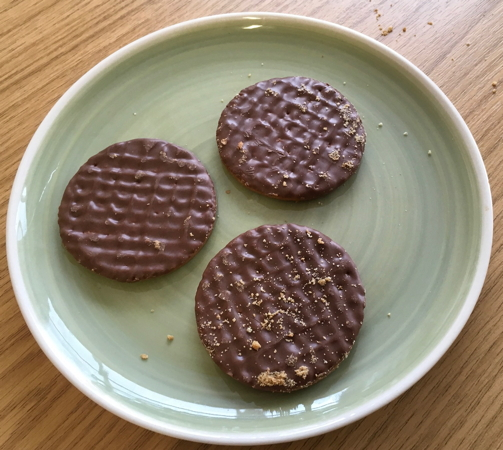 Plate with three biscuits.